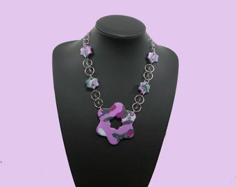 Pink/purple necklace with striking big rosette with matching earrings