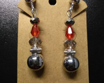 Clip on beaded dangle earrings with hematite