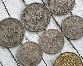 Small collection of 7 vintage UK coins; 3 x one shilling 1940s, 3 x six pence 1950s/60s, and one thrupenny bit (3 pence) 1957.