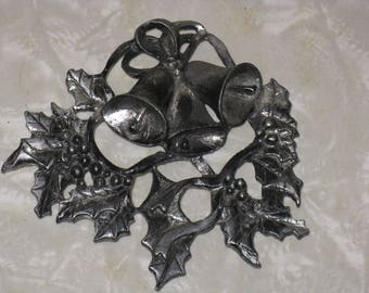 Small pewter bells and holly decoration