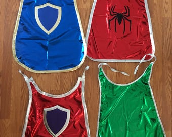Play cape for children / four different designs / nylon and lame