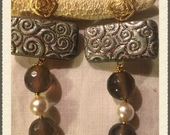Pendant earring with amber and waxed beads