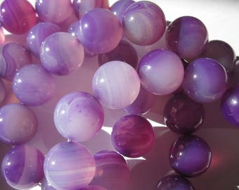 1 very large 18 mm approximately (5-3) colorful agate round bead