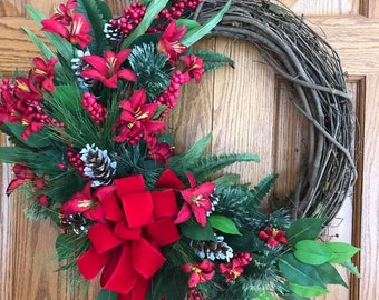 Beautiful grapevine red floral wreath with pine cones.
