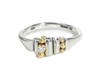 Alternative engagement ring. Silver with 18kt gold and diamond. Contemporary ring. Precious gift. Fine studio jewelry.