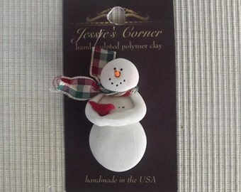 hand sculpted polymer clay snowman hold red bird pin