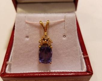 Pendant 14 k yellow gold (1.70 grs) natural  Tanzanite   emerald cut 8.70×6.5 mm 1 pc (2 cts) and natural diamond 2.3  mm 3 pcs (0.15 cts)