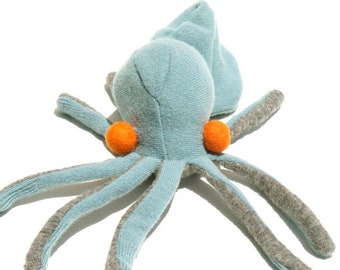 A Baby Blue and Gray Octopus with Orange Eyeballs