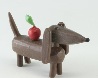 Doxie with apple
