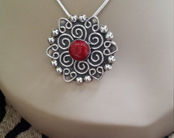 Sterling silver pendant with red jasper center stone