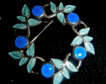 Margo De Taxco enameled brooch in blues circa 1940s in a floral and leaf motif