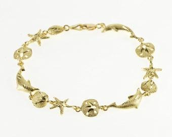 """14K Dolphin Sea Shell Ocean Motif Link Bracelet 6.75"""" Yellow Gold"""