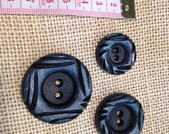 Vintage black buttons with texture
