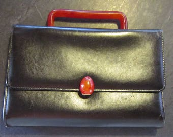 vintage little purse lucite handle and clasp very nice and unusual