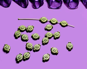 10 round beads patterned 10x06mm color bronze