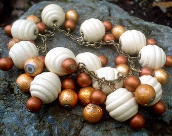 Reserved for Sheila-Lantern Bracelet in Cream, Bronze, and Brass