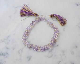6-8mm Ametrine faceted briolettes. teardrop gems. faceted gemstones. purple yellow beads