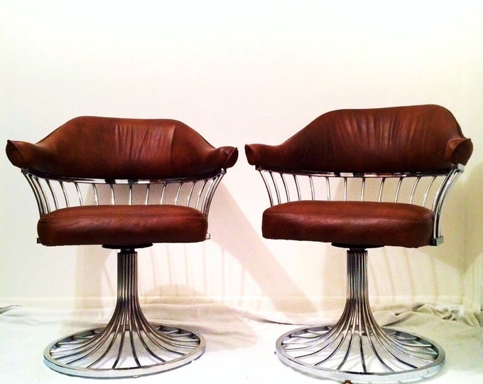 SOLD .....Pair of swivel chrome and full grain beautiful brown leather mid century chairs atomic era modern