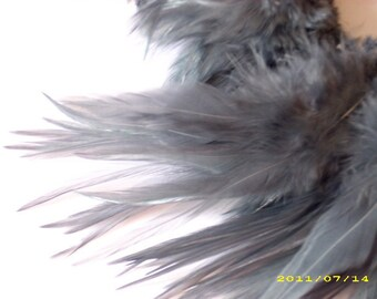 """Three inch strip steel grey Strung Rooster Furnace Saddles Feathers (individual feather 5"""")"""