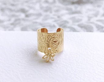 Limited**Gold Plated Floral Engraved Cuff, with a Gold Wire 3D Flower Pendant.
