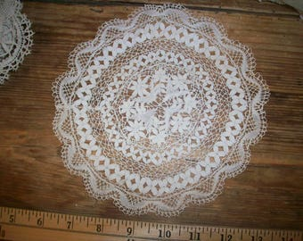 Fine hand done lace round doily