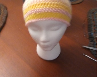 Two colored hat yellow and pink