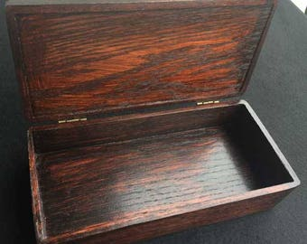 Solid oak box with hinged lid. Perfect for jewelry, keepsakes, trinkets, incense, or just about anything!