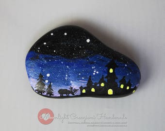 Hand-painted stone, fantasy castle and deer. Fluorescent in the dark.