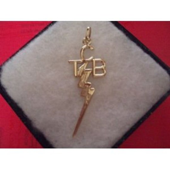 Elvis presley 14k kart gold tcb pendant taking care of elvis presley 14k kart gold tcb pendant taking care of business mozeypictures Gallery