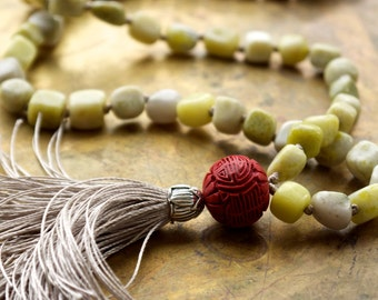Tassel necklaces Long green peridot jasper necklace Carved red chinese cinnabar bead Taupe silk Unique boho luxe fashion Green bead necklace