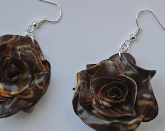 pink color flower shape earrings Brown and gold