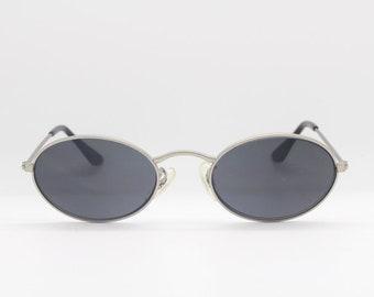 90s vintage sunglasses. Oval brushed satin finish metal frame with black lenses. NOS. Unused original. Mens. Womens. Steampunk.