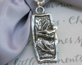 Nesting bird necklace - Pewter pendant with pearl and Sterling chain