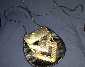vintage purse with unique metal overlay