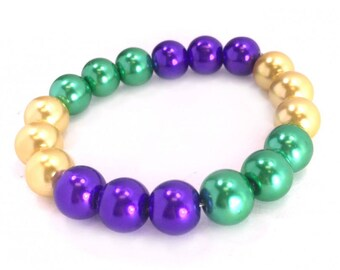 Mardi Gras 10mm stretch bracelet, 10mm pearlized glass pearls. Fenh sui in three's , great for parties, parade, tourist, from New Orleans