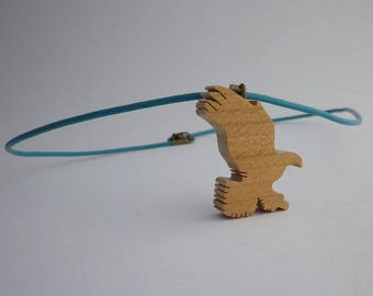 Eagle flying in cherry wood and leather pendant
