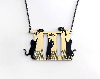 Meowrina Bay Cats necklace - gold and silver acrylic laser cut necklace