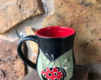 Lady Bug mug handmade thrown pottery slip trailed red and black w/green leaves 1