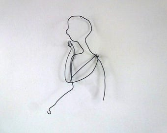 Portrait of young man in wire