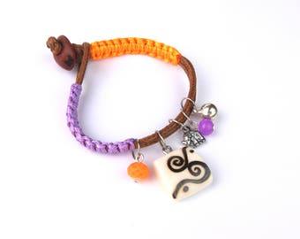 Multicolor ethnic bracelet-bone carved and pyrography by hand. Burnt Bone. Woven Cordon. Macramé