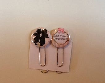 Set of two paper clips bookmark keeps love alive