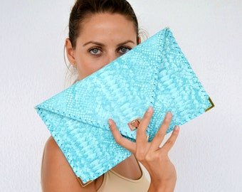 Turquoise snake pattern leather clutch