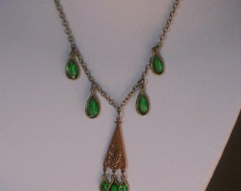 1930's gold wash over brass pendant necklace with oval framed green glass