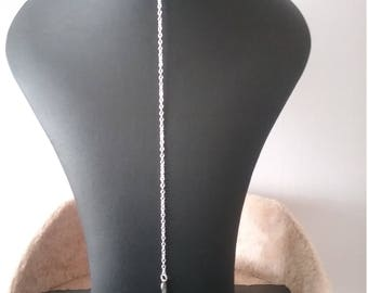 Silver necklace,lariat style with small angel wing charm.