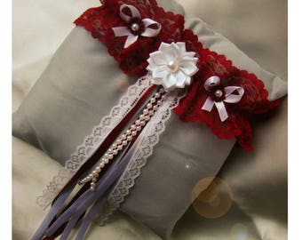 Red/Burgundy Garter, flower to be white, and white bow