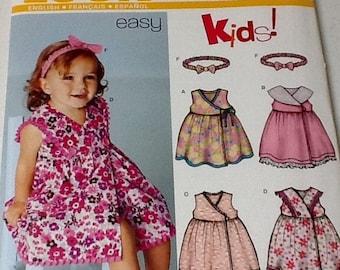 New Look Sleeveless Girls dress and headband pattern, uncut, size  nb to L