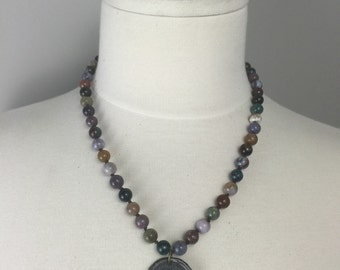Hand knotted beaded necklace with soldered vintage coin