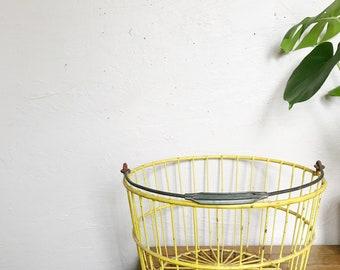 Vintage yellow metal basket, golf ball basket