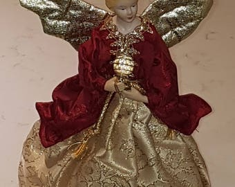 Adorable vintage tree topper, angel dressed in a gold dress and burgundy cape.