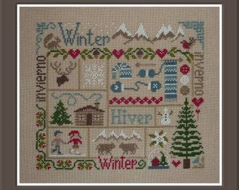 Winter Sampler – counted cross stitch chart to work in 11 colours of DMC thread.  Winter motifs and European words.  Winter design